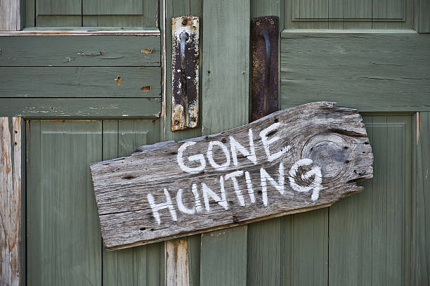 Gone Hunting. Old gone hunting sign. hunter stock pictures, royalty-free photos & images