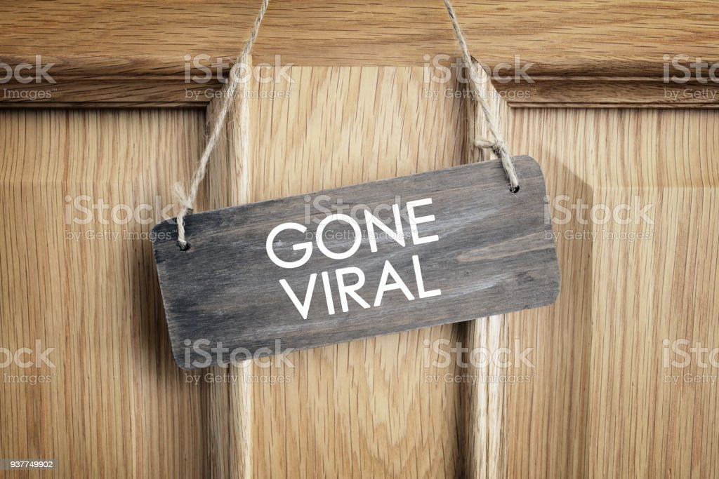 Gone viral sign on office door concept for internet marketing and social media - foto stock