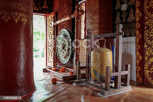 Vat Pak Khan Khammungkhun, Luang Prabang, Laos - December 8, 2018: Gong-gong and bell at the entrance of a public temple in the former capital of Laos