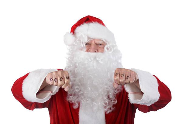 gute und schlechte santa knuckles - lausbub tattoo stock-fotos und bilder