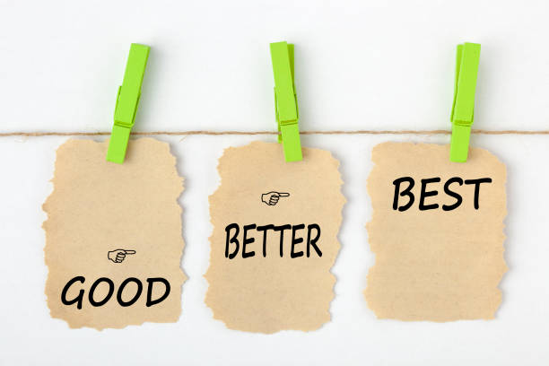 Good Better Best Concept GOOD BETTER BEST writen on old torn paper with clip hanging on white background. Business concept words. positive emotion stock pictures, royalty-free photos & images