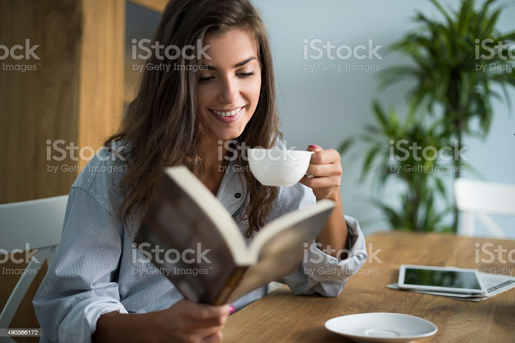 Good book and cup of coffee in the morning stock photo