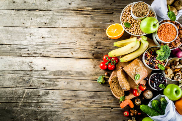 Good carbohydrate fiber rich food Healthy food. Selection of good carbohydrate sources, high fiber rich food. Low glycemic index diet. Fresh vegetables, fruits, cereals, legumes, nuts, greens. Wooden background copy space fiber stock pictures, royalty-free photos & images