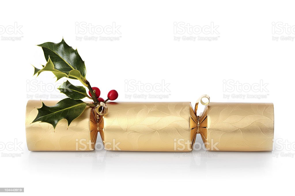 Good Christmas cracker with holly tied to it stock photo