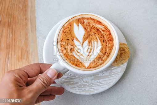 Close up adult women drinking hot cappuccino