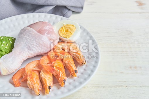 1129572695 istock photo good fat sources on a plate - chicken, seafood, egg, avocado, sesame. healthy eating and Ketogenic diet concept 1167566065
