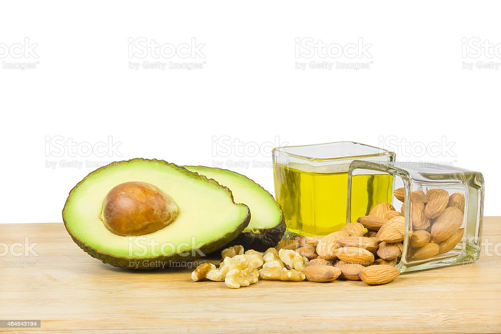Good fats diet (avocado, dry fruits and oil) stock photo