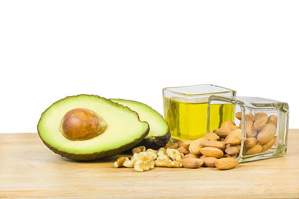 Dieta (aguacate buena grasas, frutas secas y aceite) - foto de stock