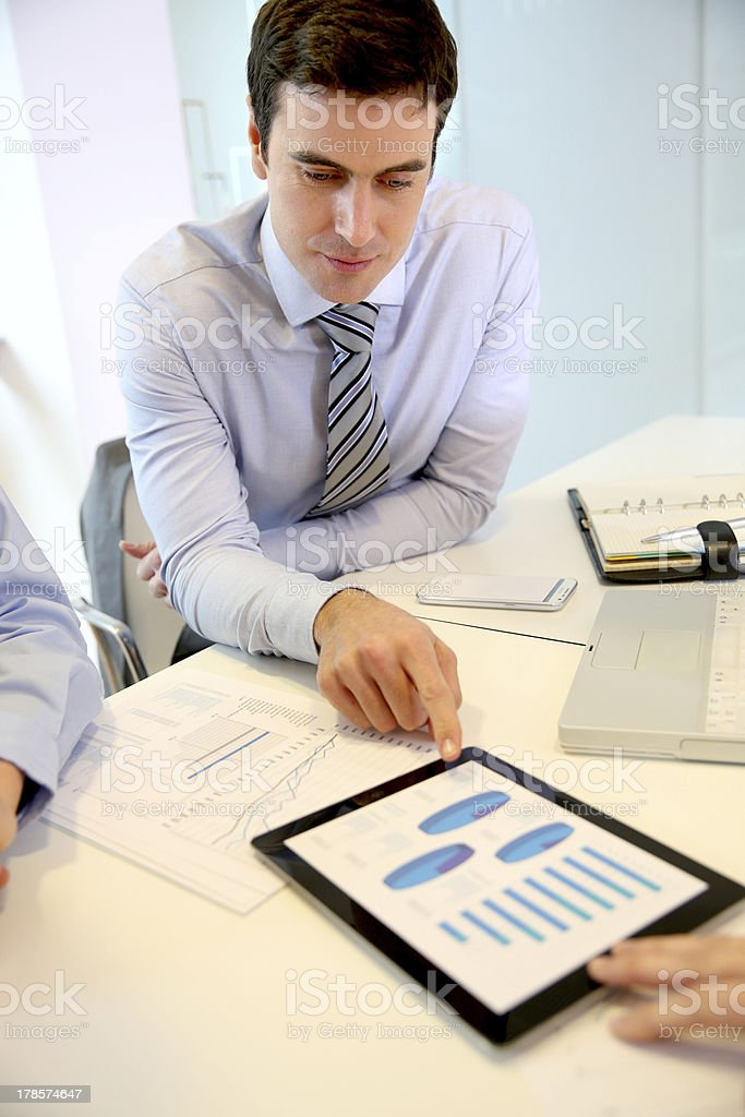 Good financial results on tablet for the businessman royalty-free stock photo