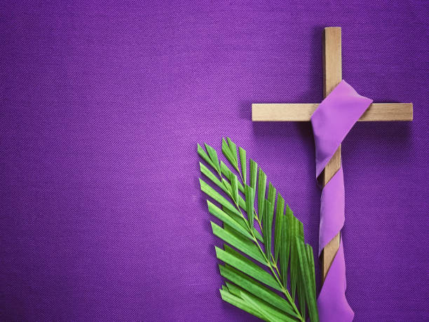 Good Friday, Lent Season and Holy Week concept. A religious cross and palm leaves on purple background. lent stock pictures, royalty-free photos & images