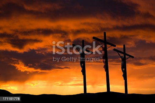 The Crucifixion at Calvary (Golgotha) near Jerusalem on Good Friday. Some copy space in the dramatic sunset.