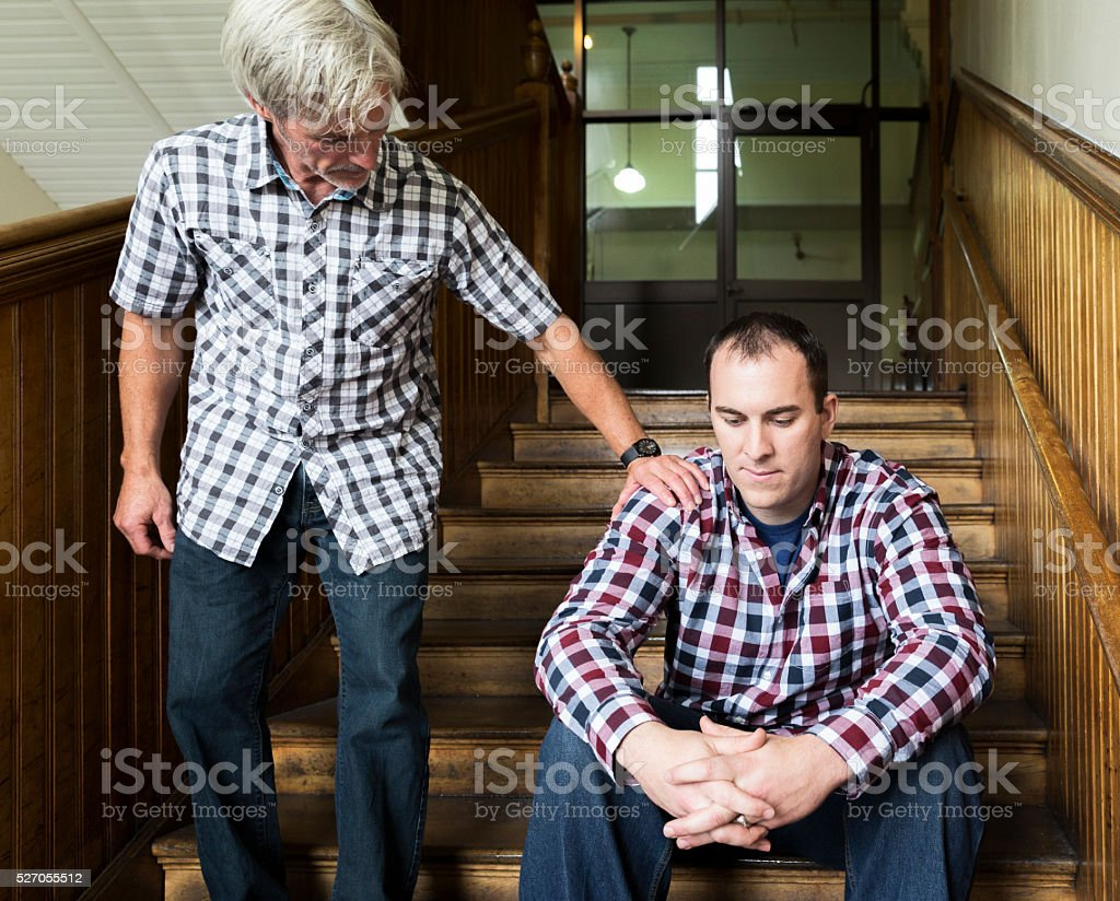 Good Friend Reaches Out to Help Another stock photo