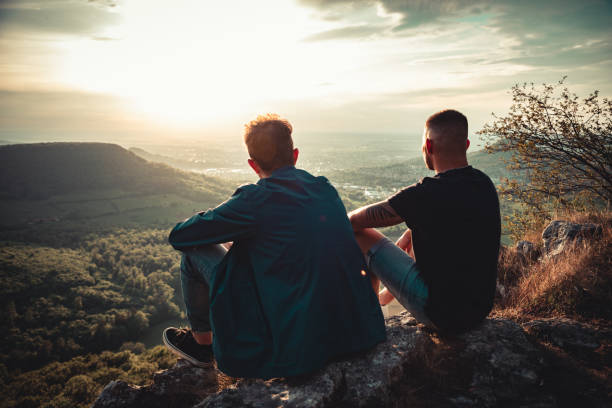 Good Friends Together Enjoying the Sunset View stock photo