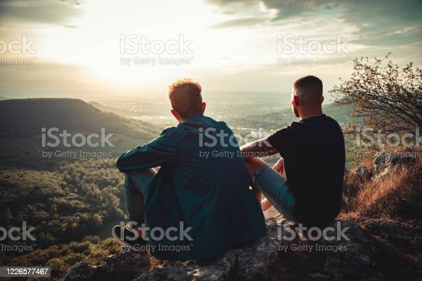 Photo of Good Friends Together Enjoying the Sunset View