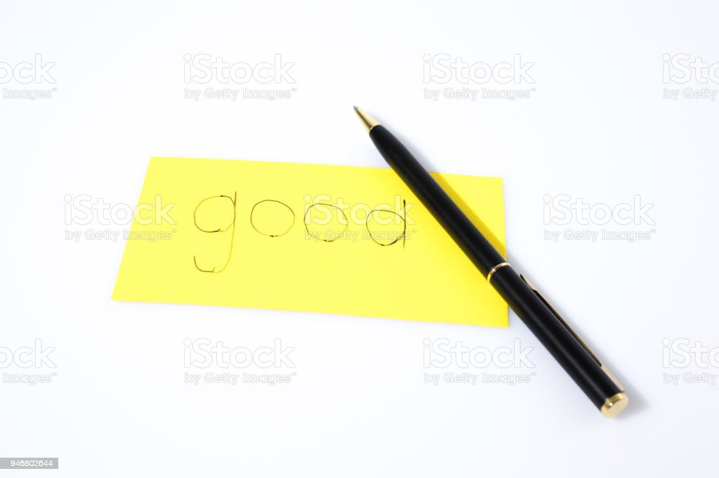 Good handwrite with a pen on a yellow paper composition stock photo