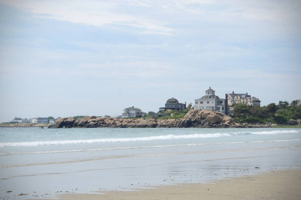 Good Harbor Beach in Gloucester, Massachusetts View of the rocks and houses along Good Harbor Beach in Gloucester, Massachusetts on Cape Ann. gloucester massachusetts stock pictures, royalty-free photos & images