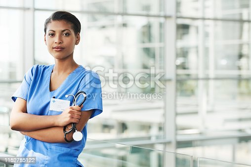 Portrait of a confident young doctor working in a modern hospital