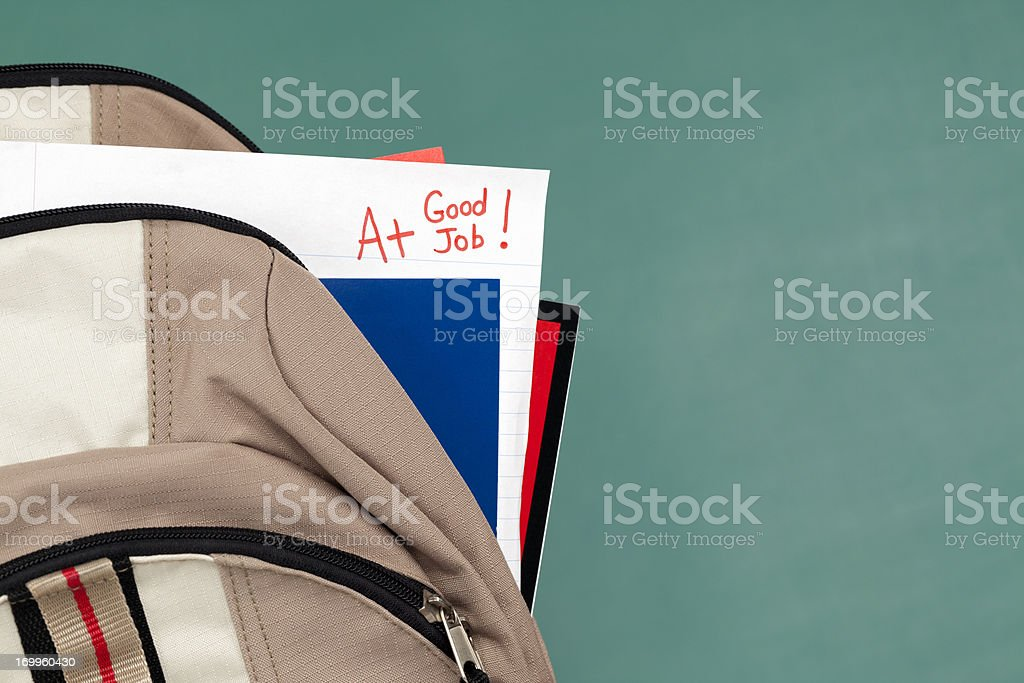 Good Job: A+ on Homework or Test Paper in Backpack royalty-free stock photo