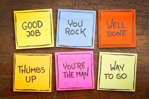 good job, well done, way to go way to go, good job, well done, you're the man, thumbs up, you rock - a set of colorful sticky notes with positive affirmation words against rustic wood encouragement stock pictures, royalty-free photos & images