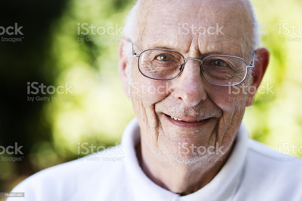 Good looking and contented man in his 80s smiles gently royalty-free stock photo