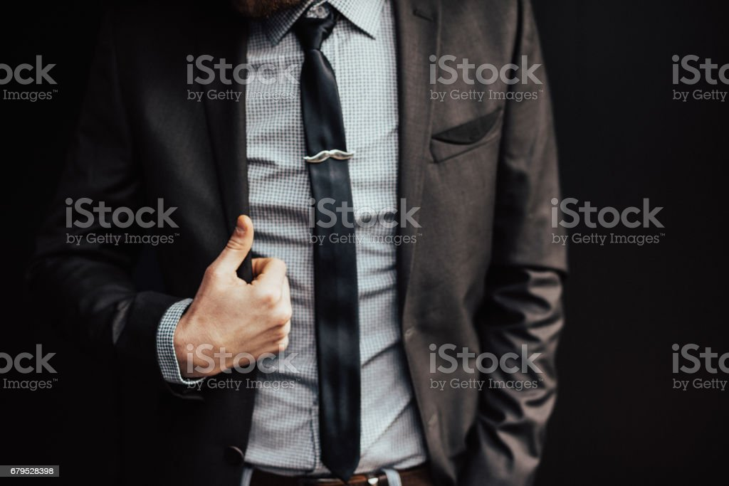 Good looking business entreprenuer on a dark background royalty-free stock photo