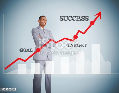 904389218istockphoto Good looking businessman standing behind graphics 504705429