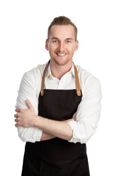 Good looking chef in black apron stock photo