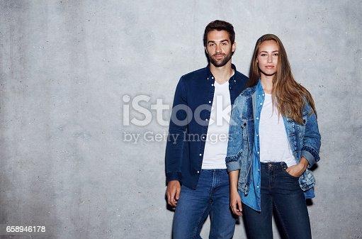 Good looking duo in double denim, portrait