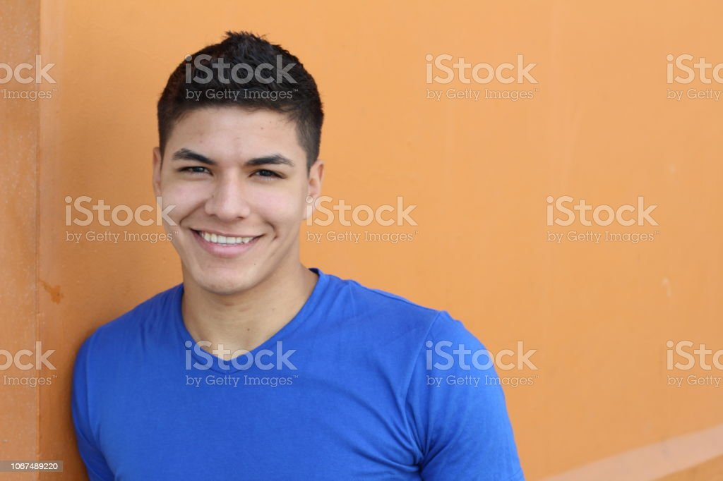 Good looking ethnic young male smiling royalty-free stock photo
