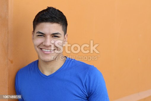 Good looking ethnic young male smiling with copy space.