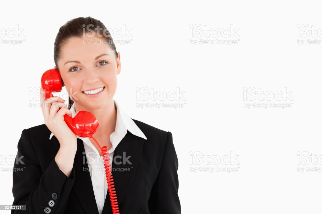 Good looking female in suit on the phone stock photo