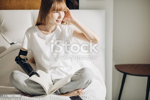 istock good looking girl thinking about something while reading a novel 1176972860