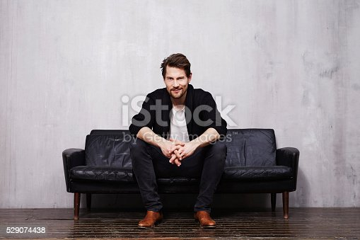 Good looking guy on sofa in portrait