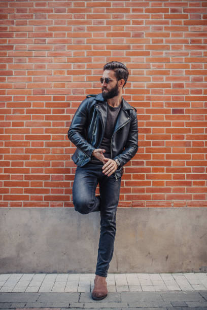 Good looking man Handsome young man posing outdoors leather jacket stock pictures, royalty-free photos & images