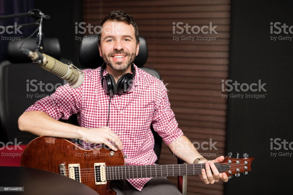 Portrait of a good looking young musician and composer playing the...