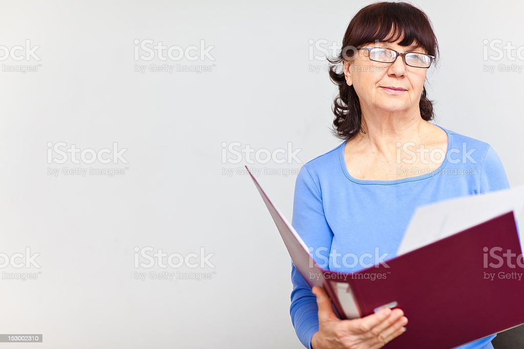 Good looking senior woman with folder royalty-free stock photo