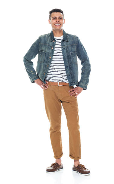Good looking tall black man wearing denim jacket - hands on hips Good looking tall black man wearing denim jacket - hands on hips akimbo stock pictures, royalty-free photos & images