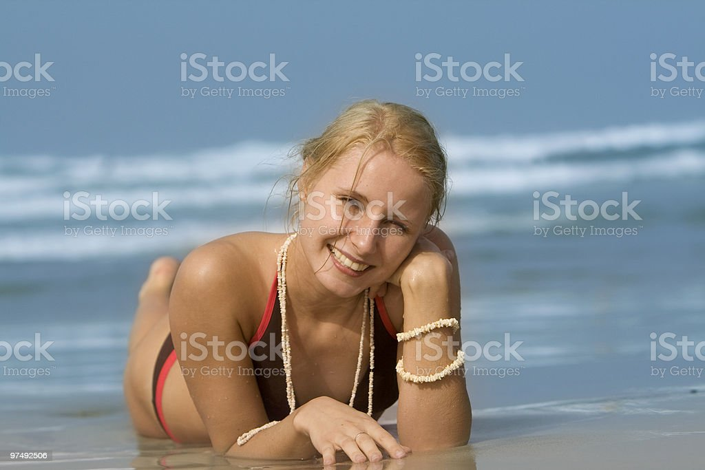good looking woman rolling around in the surf royalty-free stock photo