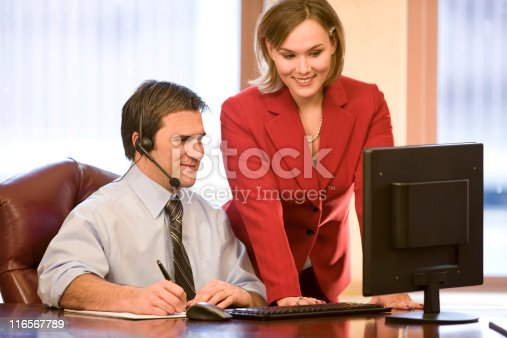 513583458 istock photo Good Looking Young Businesspeople at Computer 116567789