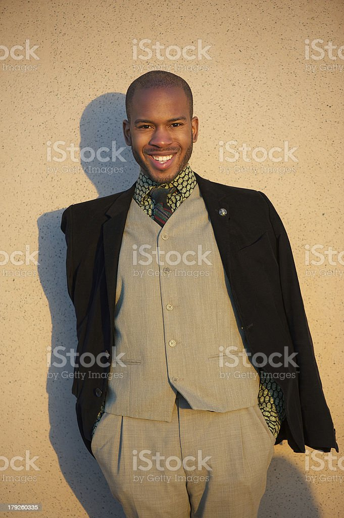 Good looking young man smiling outdoors royalty-free stock photo