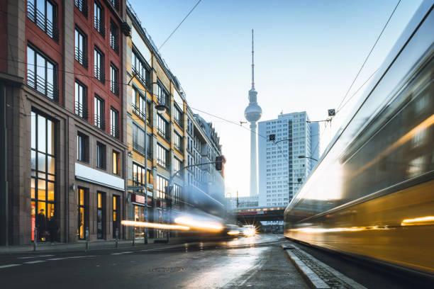 good morning Berlin long exposure of yellow street car in Berlin Mitte at sunrise hour in front of TV-Tower berlin stock pictures, royalty-free photos & images