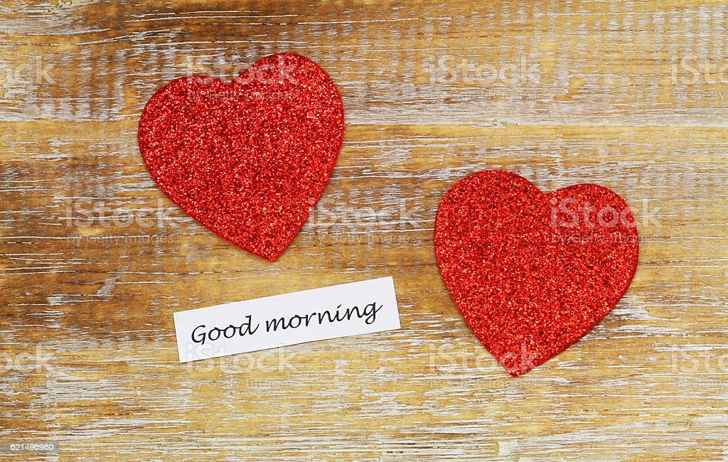 Good morning card with two sparkling hearts on rustic wood Lizenzfreies stock-foto