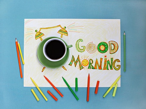 Good morning coffee and alarm clock concept.  Cup of coffee with hand drawn alarm clock