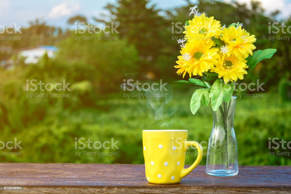 Good morning coffee and yellow flower vase stock photo more good morning coffee and yellow flower vase royalty free stock photo mightylinksfo