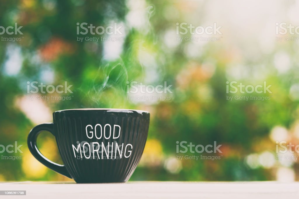 Good morning greeting a cup of coffee stock photo