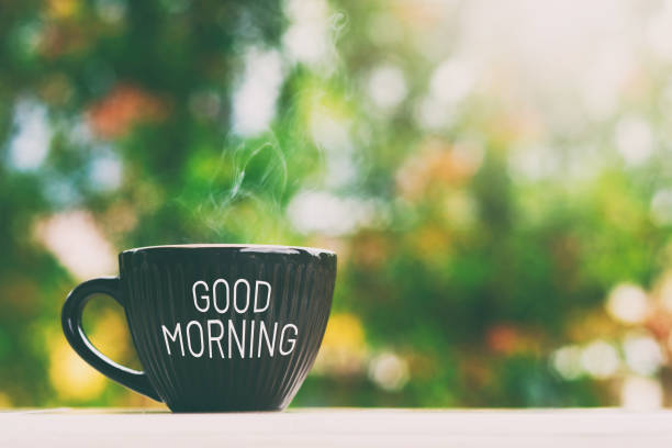 good morning greeting a cup of coffee - monday motivation stock photos and pictures