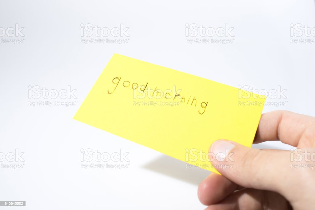 Good morning handwrite with a hand on a yellow paper composition stock photo
