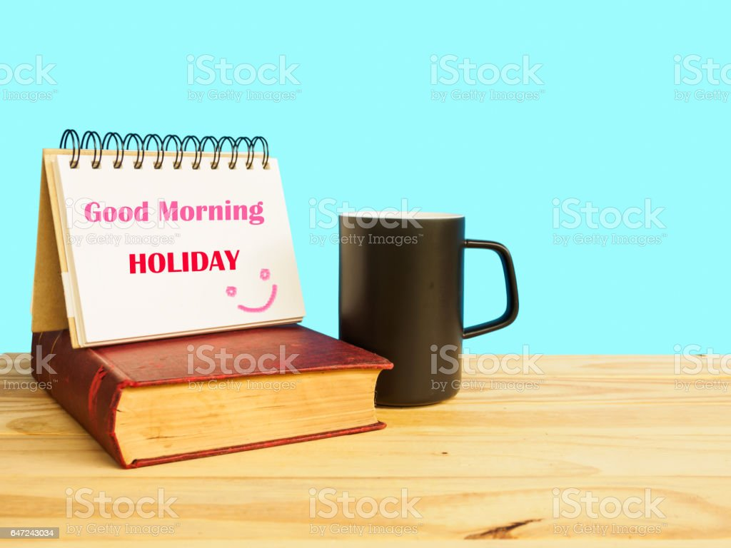 Good Morning Holiday Word Coffee Cup And Old Book On The