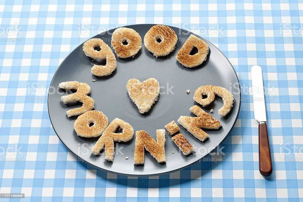 good morning letters made out of toasted bread on plate royalty-free stock photo