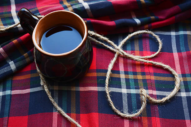good morning Cup of coffee on a checkered tablecloth and a heart of harness devolve stock pictures, royalty-free photos & images